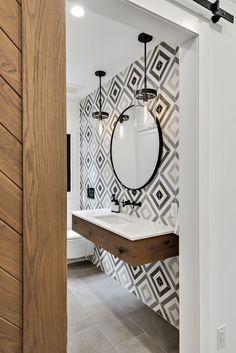 fine millwork and design services Bathroom Grey, Basement Bathroom, Modern Bathroom, Bathroom Ideas, Floating Floor, Floating Vanity, Grey Floor Tiles, Grey Flooring, Tile Accent Wall