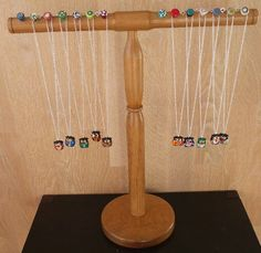 Necklace display stand in ash with glass lampwork buttons & owl pendants by Ann