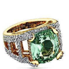 As a green-eyed woman spell binds with beauty of her eyes, this emerald @Rodery Mangrove ring with the diamonds fascinates even inveterate gem collector.