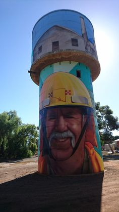 The disused water tower near the town's centre now depicts the bright faces of local volunteers and sports stars, including the games record holder of Blyth Snowtown Football Club, Simon McCormack. Street Art News, Street Mural, 3d Street Art, Street Art Graffiti, Street Artists, Graffiti Artists, Banksy, Art Du Monde, New York Graffiti