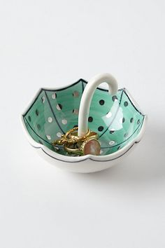 Cute ceramic umbrella ring dish. Great idea and nice mint color with polka dots! So girly! #anthrofave #anthropologie #umbrella #ring #dish #mint #polka #design #ceramic #jewels