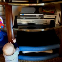 Babyproofing with pool noodles. This was really easy and cheap.  Works great!