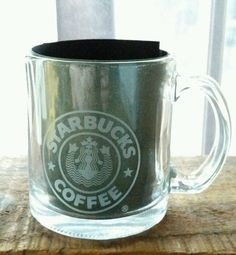 Cup has banned mermaid logo, with split tail and navel. Starbucks clear glass 14 oz coffee mug. Perfect for coffee, tea, latte, cocoa or add to your collection for display.