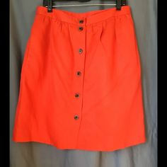 Linen A-line skirt This skirt is fabulous for a casual summer outfit. The button closure in the front along with the pockets make it perfect for summer daytime or evening activities. It's a tighter woven linen and the shade of orange is fairly true to the photos. J. Crew Skirts A-Line or Full