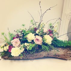 Garden Roses, Carnations, Moss, Ferns and Birch Branches on a log by Living Fresh