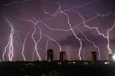 Lightning over Dallas I believe. Photographed by Mike Mezeul. Absolutely beautiful.