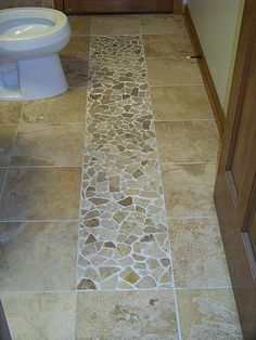 "stone ""path"" accent in tile floor"