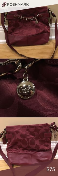 Coach signature sateen chain duffle Authentic coach sateen chain duffle in cranberry. Was a gift I just never used... only one tiny scratch (pictured) on bottom left due to storage. Coach Bags Crossbody Bags