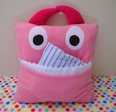 "This monster is safe- it only ""eats"" PJ's :  )This tutorial has been a long time coming – but finally, here it is!  These cute and cuddly monster pillows have big mouths just ready to eat your pajamas and keep them safe until night time.  They're also really fun sleepover companions.  If you'd like to have one of these monsters for your very own (or for someone you …"