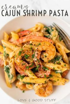 Easy, creamy, cajun shrimp pasta. This healthy pasta dish has a light creamy sauce and is packed with fresh veggies and seasoned shrimp. On the table in under 30 minutes, it's the perfect meal for any occasion.