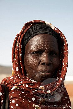 Africa | South Sudanese woman bearing tribal scarification markings | ©Robert Harding