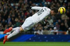 James Rodríguez of Real Madrid scores the opening goal from a header during the La Liga match between Real Madrid CF and Sevilla FC at Estadio Santiago Bernabéu on February 4, 2015 in Madrid, Spain.