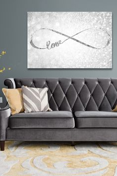 Two Fallon pillows from Surya spotted on this traditional gray sofa! (FA-017 and FA-035) #suryaspaces