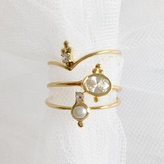 From top to bottom: 'Catalyst' ring, 'Ellipsis' ring, 'Wisdom' ring.   Stacking Rings Gold Pearl Dainty Delicate Minimal | Sit & Wonder
