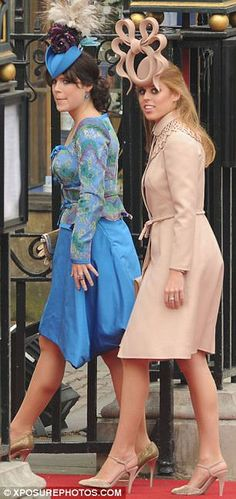 (L-R) Princess Eugenie and Princess Beatrice of York.  The Princesses have come under fire for their outlandish outfits.