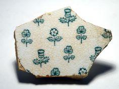 Pottery shard with the English rose, Irish shamrock and Scottish thistle. Found 27/216