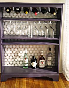 How To: Turn a Bookcase Into a Bar. Have an old (and cheap) bookcase left over from college or uni apartment? Instead of trying to find a place to dump it, refinish or paint, use some Dollorama dish racks upside down and presto!! Easy and useful bar area!