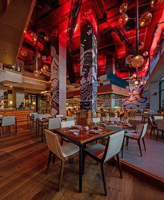 "Tasca and Netsu Restaurants at the Mandarin Oriental Jumeira, Dubai - dpa lighting consultants - ""Right Light, Right Place, Right Time"" ™ #dpalighting #lightingdesign #restaurantlighting #barlighting #pendants #concealedlight #uplighting #redlight #warmlight"