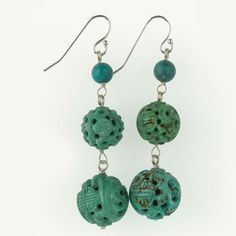 Drop earrings made of old deep carved Chinese turquoise longevity beads and smooth turquoise rounds on sterling silver wire and ear wires. Bottom bead measure 14mm, middle bead measures 10mm and top bead measures 5mm. Total length is 2 1/8 inches. Newly assembled old Chinese hand carved green turquoise.