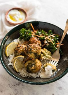 These Baked Broccoli Cheese Balls are an outrageously delicious meat-free meal or fabulous bites to serve at a gathering. Served with a Lemon Yoghurt Sauce.