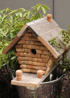 Hey, I found this really awesome Etsy listing at http://www.etsy.com/listing/176215573/rustic-wine-cork-wood-bird-house