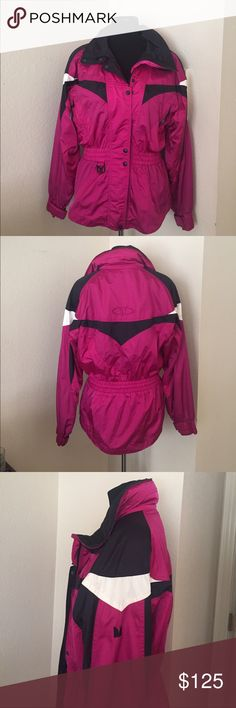 Woman's Fitted Ski Jacket Beautiful pink, black, and white fitted women's ski jacket with a gathered waist with a drawstring inside. Made of waterproof fabric, with multiple inside and outside pockets. A hood is attached in a hideaway pocket behind the neck and each wrist has adjustable cuffs. The long zipper zips all the way up to the chin with heavy duty snaps. This jacket has been minimally worn, is a women's size 10, and would go with any color pants. Couloir Jackets & Coats Utility…