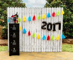 """Say """"cheese!"""" Create a custom photo backdrop with fun props to commemorate your grad!"""