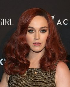 Pin for Later: 15 Celebrities Who Shocked Their Fans by Wearing a Wig Katy Perry Katy attended the Harper's Bazaar Icons party with a stunning auburn wig. She looks so flawless that we hope she dyes her hair this hue!