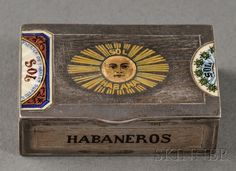 German .900 Silver and Enamel Match Safe, early 20th century, Louis Kuppenheim, maker, decorated as a cigar box with enamel scenes of Havana, a sunburst and foliage, with inscriptions.