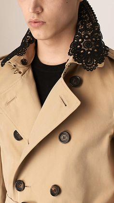 A cotton gabardine Burberry trench coat with a detachable graphic lace topcollar. Discover the men's outerwear collection at Burberry.com