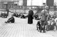 """Polish priest and other Polish civilians as German hostages awaiting execution in Bydgoszcz, Poland, September 1939. The executions were revenge killings for Bloody Sunday, when ethnic Germans living in the same town were subjected to mysterious killings two days before the German invasion. The German army immediately perceived the killings as a Polish-instigated massacre. The exact facts about Bloody Sunday are still disputed."""