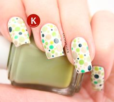 Dotted green nails