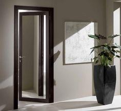 Porte in legno massello di meranti spazzolate e - Porte scorrevoli specchio ...