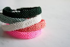 Monochrome Friendship Bracelets | The Purl Bee I have to learn how to make these-with a single pretty bead at the middle of each diamond