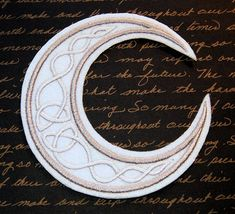 This shimmery silver crescent moon is filled with Celtic swirls. Size: Small: 2.86 x 2.84 (72.6 x 72.1 mm)  Medium: 3.86 x 3.84 (98.0 x 97.5 mm)