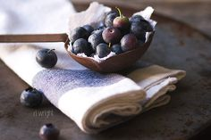 Food styling blueberries in a old ladle