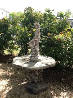 concrete table is two piece -- statue is a spitter for a fountain