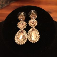 Elegant silver tone diamond like earrings Used once. One stone missing see pic 3 Jewelry Earrings