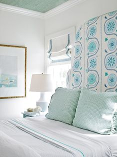 A bit of tape on a roman shade can tie an entire room together, from the ceiling to the Euro shams and a statement headboard.