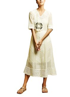 A combination of rich textures and a midi-length silhouette make this sheer dress from Kanelle perfect for the classic woman. This elbow-sleeve dress features a relaxed fit in a neutral shade of off-white with a simple V-neckline and a soft skirt that takes on a subtle A-line shape for added comfort. It has been layered over a straight cut inner.