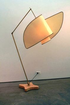 Cadma, a floor light by Carlo Mollino dating from c.1994. Like the wings of a nun's head dress....