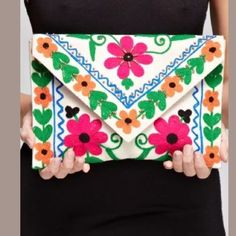 Love Stitch Floral Clutch Cross Body Bag Purse This stunning, Spanish inspired purse can be worn as a cross body or as a clutch. Gorgeous, high quality, embroidered design with beaded trim. Total height is 7 inches. Width is 10 inches. Chain strap is 20 inches. Hits about the waist. Cotton blend Love Stitch Bags Crossbody Bags