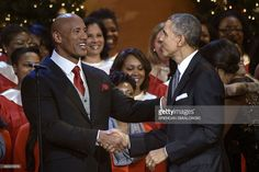 Dwayne 'The Rock' Johnson (L) and US President Barack Obama shake hands