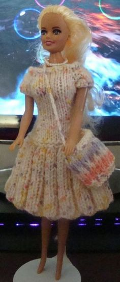 Crochet Toy Barbie Clothes Basic dress with capped sleeves and pleated skirt. Barbie Clothes Patterns, Crochet Barbie Clothes, Doll Clothes Barbie, Barbie Dress, Clothing Patterns, Barbie Doll, Barbie Knitting Patterns, Knitting Dolls Clothes, Crochet Doll Pattern