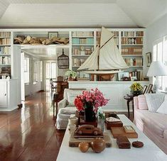 Built-in bookshelves / Home for India Hicks and her family is a 1950s five-bedroom Bahamian beach house