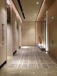 Modern office elevator lobby ceiling lights google for Elevator flooring options