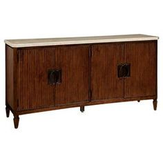"""Perfect for stowing dishware in the dining room or displaying a spread of desserts at your next soiree, this elegant buffet features ribbed detailing and a stone-top accent.   Product: BuffetConstruction Material: Mahogany wood veneers, select hardwood solids and stoneColor: TruffleFeatures:  Stone topFour doors Two interior tray drawers Silverware tray Adjusable wood shelvesDimensions: 38"""" H x 75"""" W x 20"""" D"""