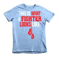 Start them early with kids boxing t-shirt...a version of American Apparel's most popular adult boxing t-shirt. It features durable ribbed neckband and a double-needle bottom hem and sleeves. • 100% je