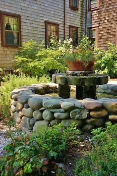 Stone water feature with a millstone water feature | Flickr - Photo Sharing!
