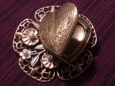 1980's Victorian Style Heart Locket. Sold on Etsy. For background info, go to Flickr.   For more beautiful, vintage jewelry, see our vintage jewelry shop on Etsy at https://www.etsy.com/shop/WildersideJewelry?ref=s2-header-shopname